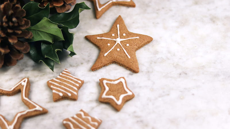 Christmas cookies in the shape of stars (Lydia Matzal via Unsplash)