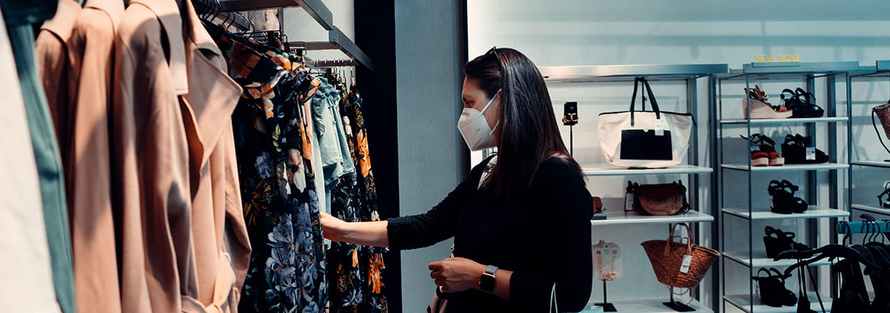 Woman shopping in mask