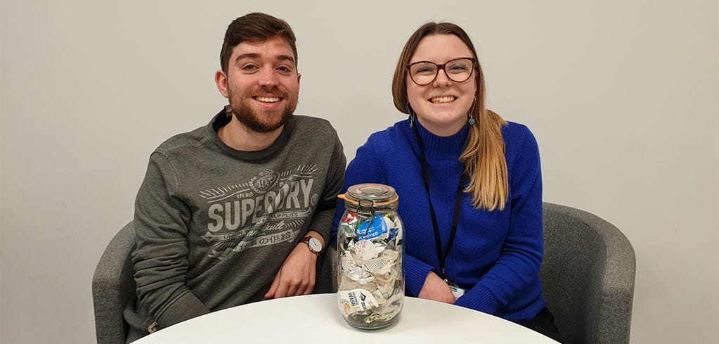Jack Wakefield and Caitlin Collins with their jar of rubbish from 2019 (Tearfund).