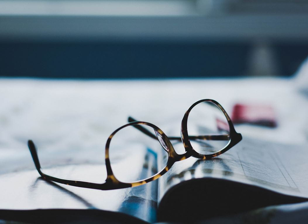 Glasses on an open magazine