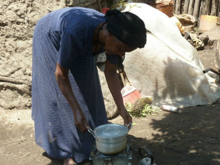 Tsige preparing a meal