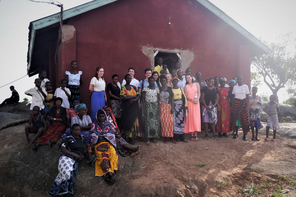 The women of Kwikuba with Tearfund volunteers