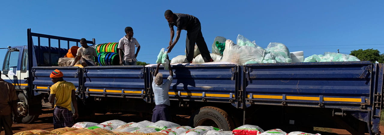 Workers loading sacks of aid onto truck