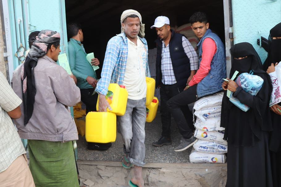 A food distribution in Yemen. Photo credit: Mohammed Jamal