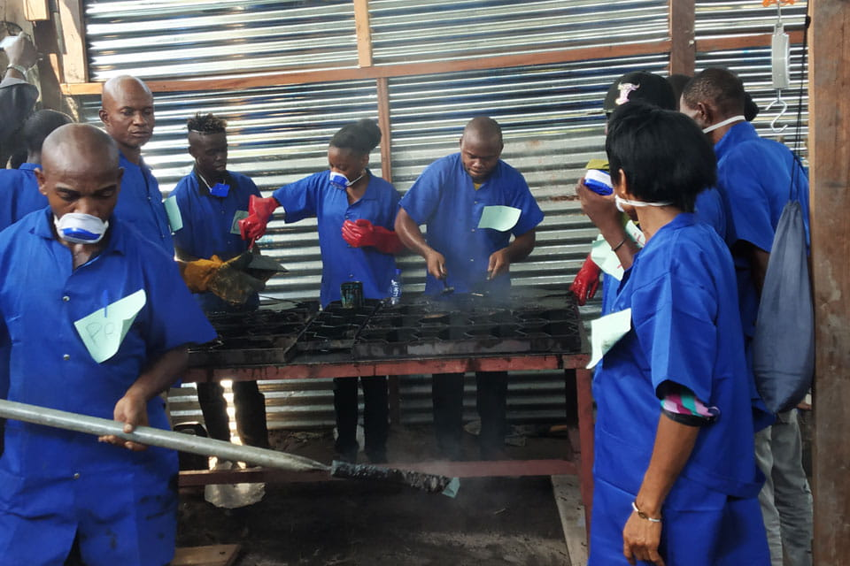 Workers making the recycled tiles