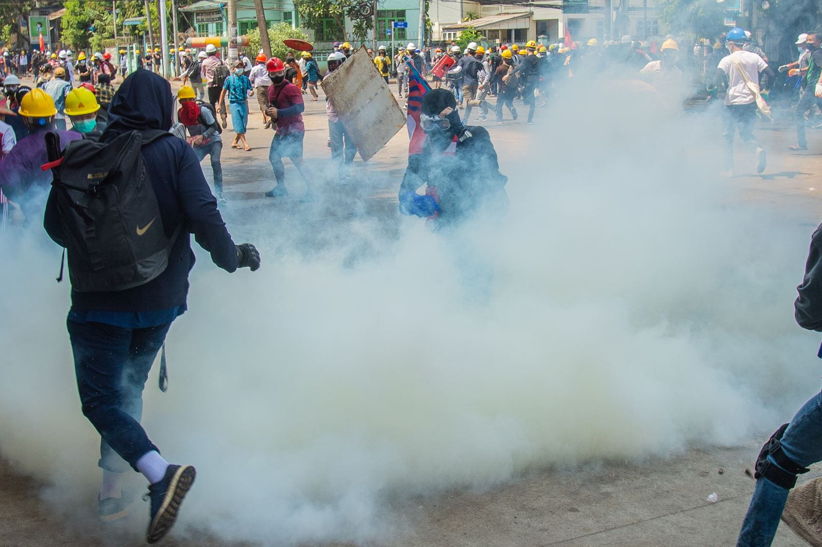 Police crack down on the crowd with tear gas protesters in Yangon, Myanmar (credit: Maung Nyan/Shutterstock)