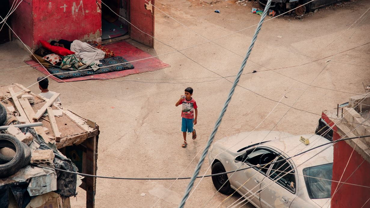 A child walks through an informal refugee settlement in Beirut, Lebanon. Credit: Ruth Towell/Tearfund