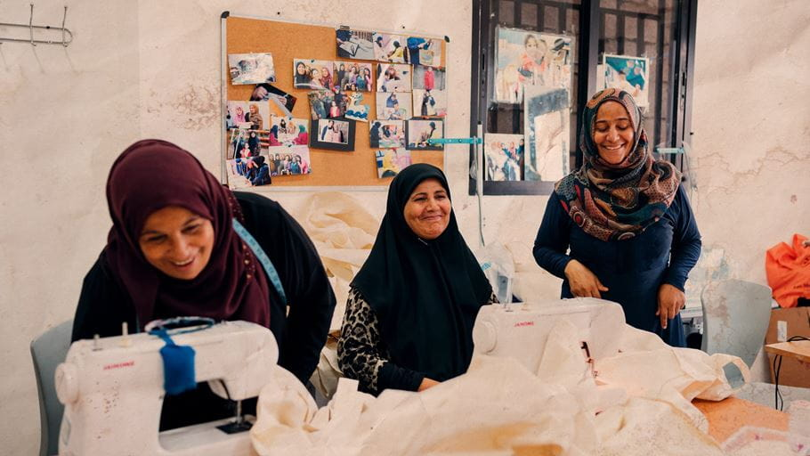 Tamam joins other refugees at the Tahaddi Education Center's sewing programme.