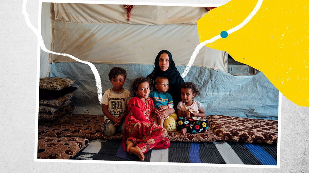 Lady sitting in a tent with four children