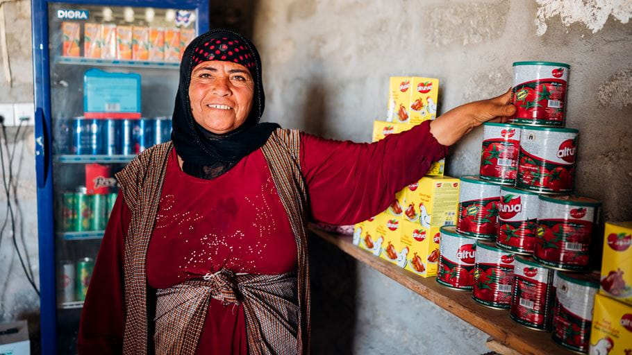 A lady standing in a shop