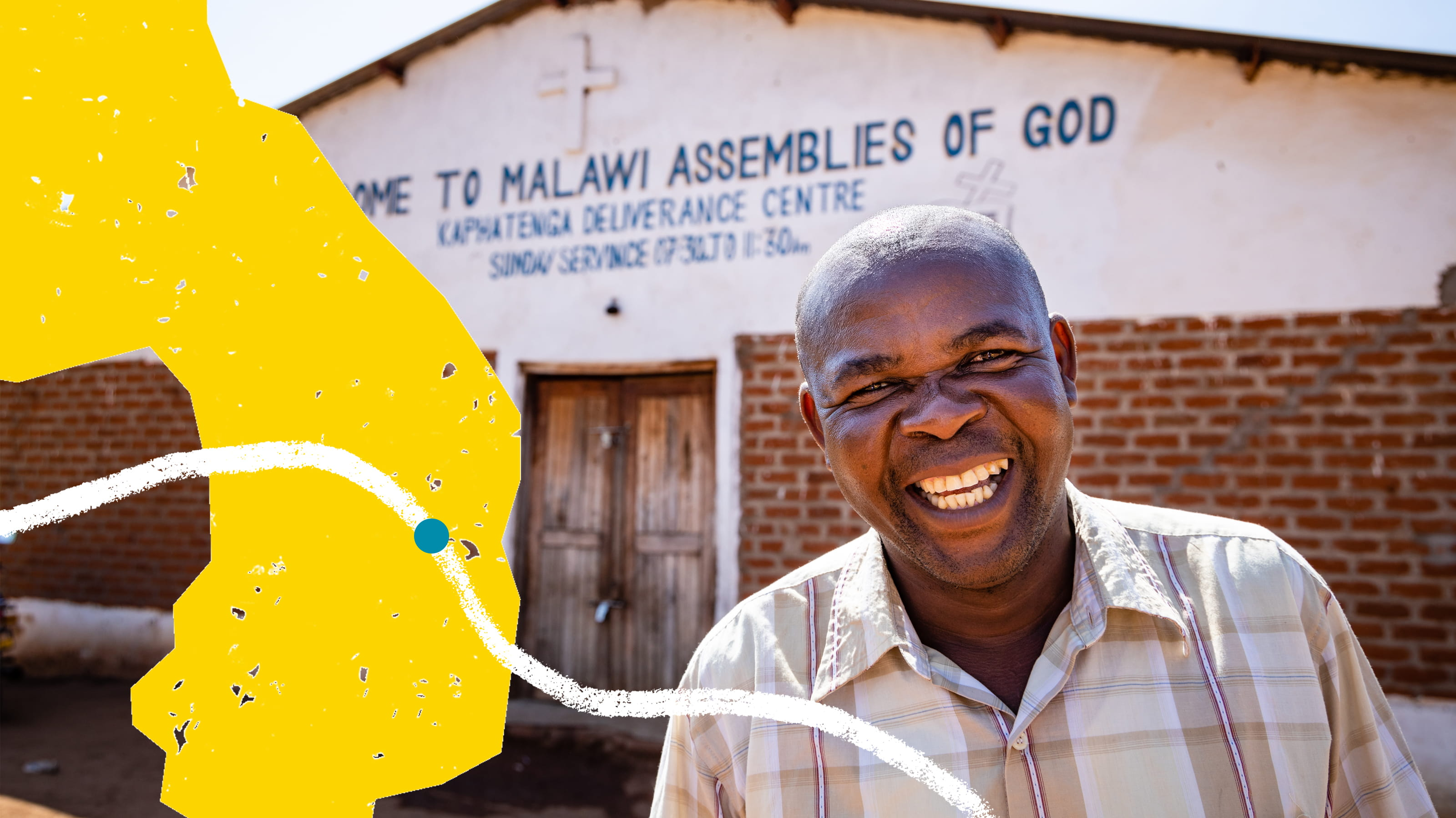 Smiling man standing outside Malawi Assemblies of God Church