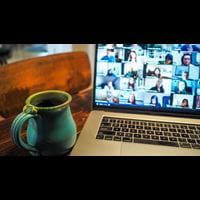 Laptop showing video call (Unsplash)